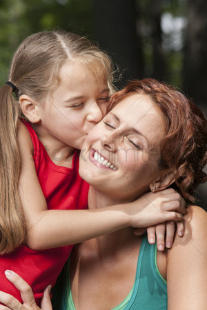 Kissing : Portrait of mother and daughter together