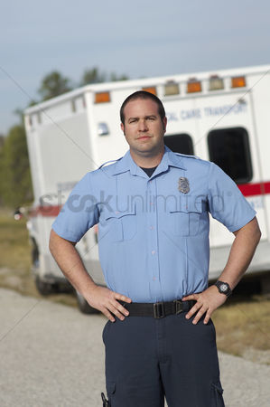 On the road : Portrait of paramedic in front of ambulance