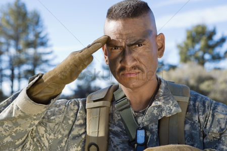 Respect : Portrait of saluting soldier