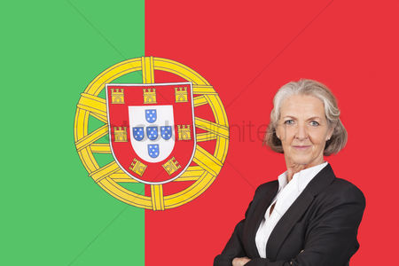 Respect : Portrait of senior businesswoman with pride over portuguese flag
