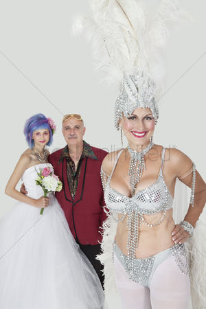 Man suit fashion : Portrait of senior showgirl with father and daughter in wedding dress against gray background