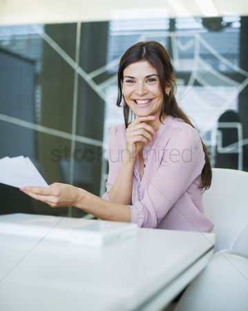 Czech republic : Portrait of smiling young businesswoman with documents at conference table