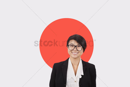 Respect : Portrait of young businesswoman smiling over japanese flag