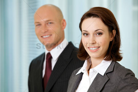 Bald : Portrait of young caucasian businessman and businesswoman in office