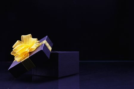 No people : Purple gift box with yellow ribbon