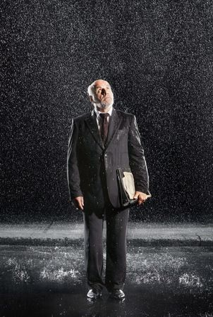 Bald : Rain falling on businessman without protection looking to sky