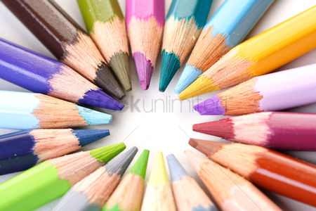 Black background : Rainbow colored pencils - close-up