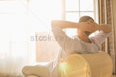 40 44 years : Rear view of man relaxing on chair at home
