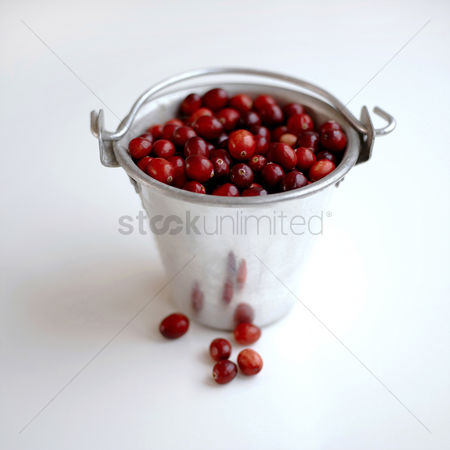 Appetite : Red berries stored in an aluminium bucket