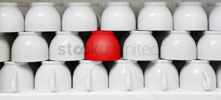 Collection : Red cup amid white coffee cups