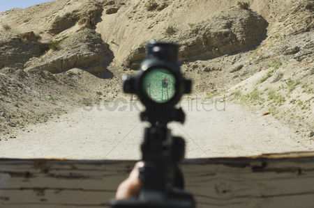 Firing : Rifle sight aiming at target on firing range