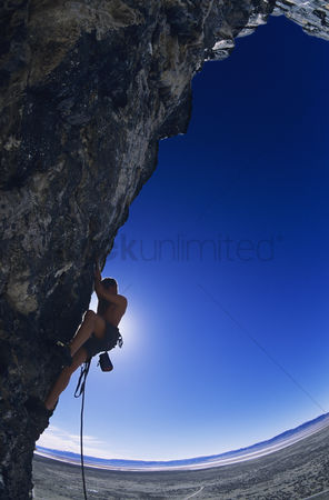 Fitness : Rock climber on cliff face