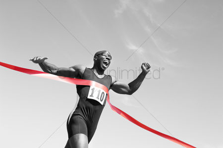 Fitness : Runner crossing finish line