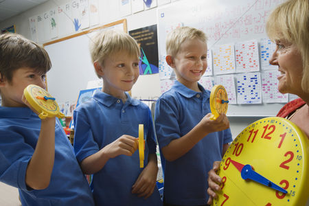 Educational : Schoolboys learning to tell time