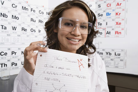 High school : Science student showing off good grade