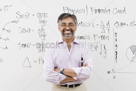 Teacher : Scientist standing in front of whiteboard
