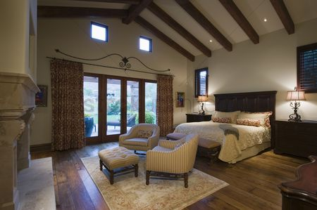High ceiling : Seating area in beamed palm springs bedroom
