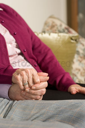 Interior : Senior couple holding hands