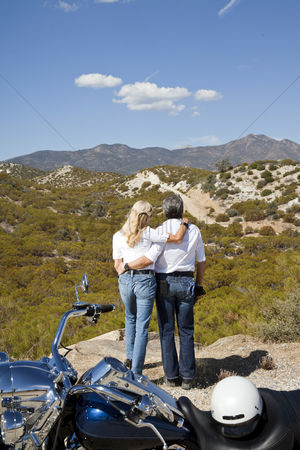 On the road : Senior couple look out to desert mountains