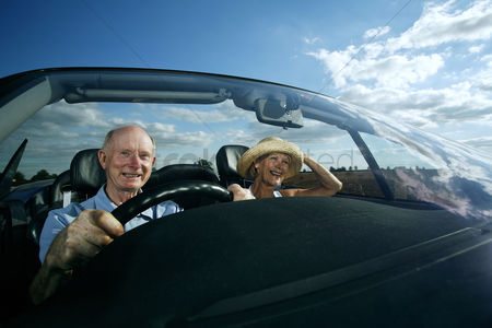 Transportation : Senior couple travelling together in the car