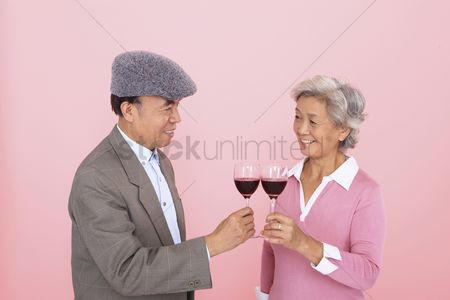Toasting : Senior man and senior woman toasting wine