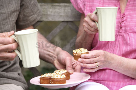 Husband : Senior man and woman enjoying their teatime