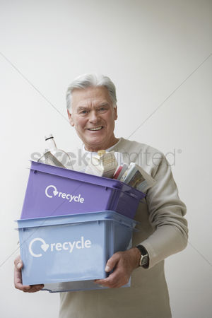 Satisfying : Senior man carrying recycling bin