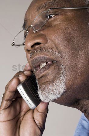 Cellular phone : Senior man with glasses talking on the phone