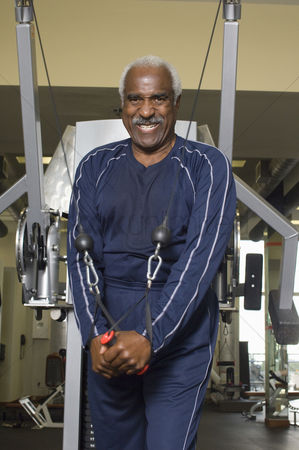 Workout : Senior man working out on weightlifting machine