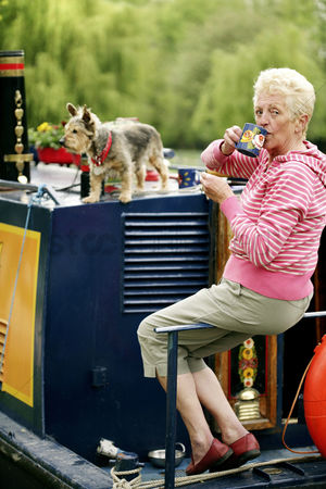 Houseboat : Senior woman enjoying a cup of coffee