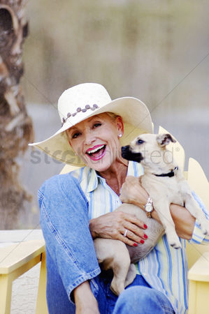 Relaxing : Senior woman posing with her dog