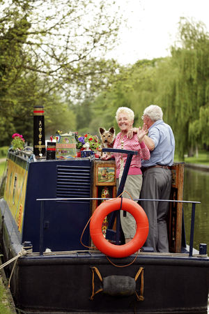 Houseboat : Senior woman waving to the camera