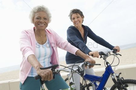 Two people : Senior women on cycle ride
