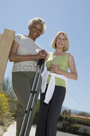 Women group outside : Senior women stand with walking poles