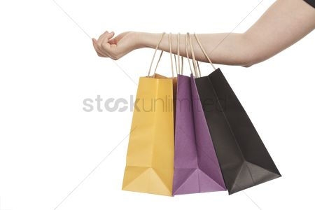 Sales person : Shopping bags on an arm