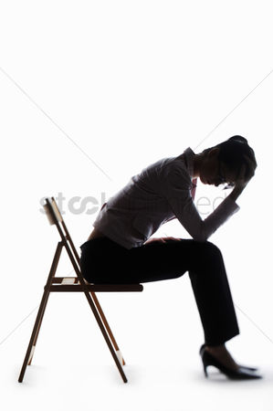 Business : Silhouette of a depressed businesswoman