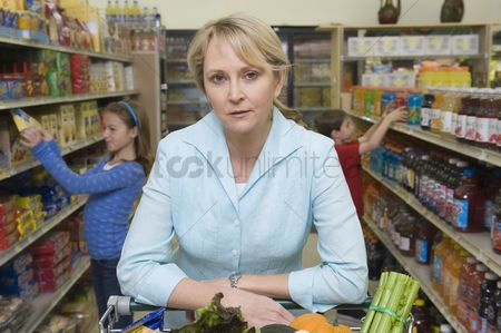 Shopping cart : Single mother shopping with son and daughter