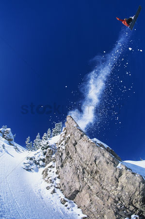 Jacket : Skier jumping from mountain ledge