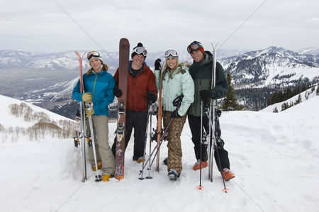 Women group outside : Skiers holding skis on mountain