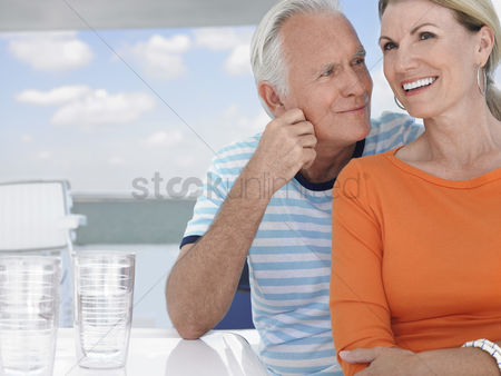 Retirement : Smiling middle-aged couple outdoors portrait