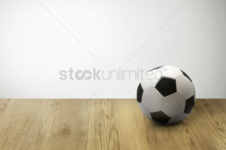 Match : Soccer ball on parquet floor