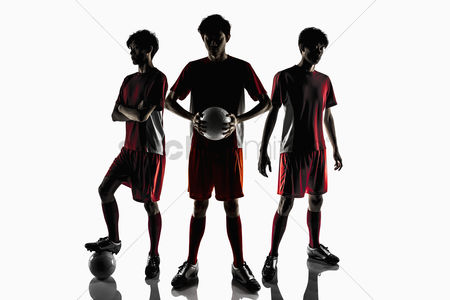 Match : Soccer players posing with soccer balls