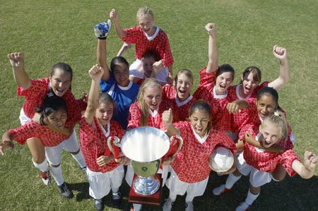 Children : Soccer team celebrating victory