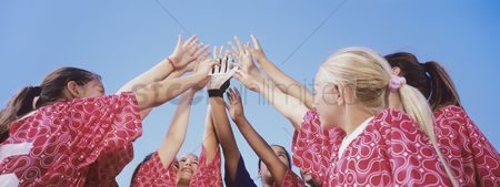Head shot : Soccer team giving high five