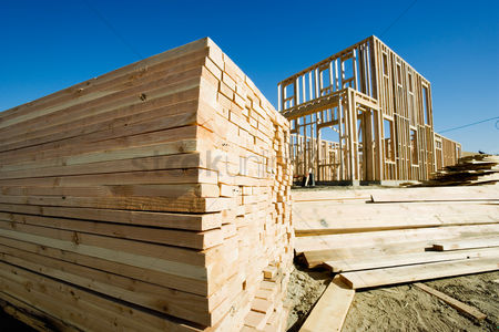Pile : Stack of lumber frame of house under construction