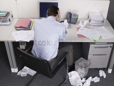 Office worker : Stressed businessman at office desk