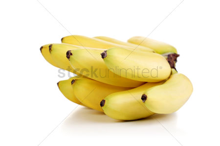 Abstract : Studio shot of bunch of bananas