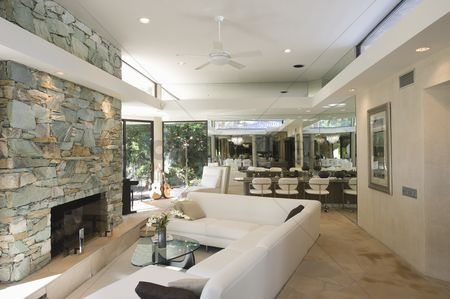 Furniture : Sunken seating area and exposed stone fireplace of palm springs home interior
