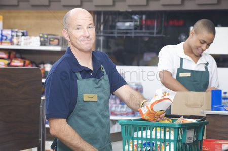 Bald : Supermarket employee and check out assistant