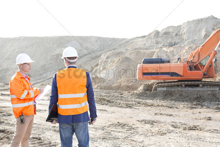 Supervisor : Supervisors standing at construction site against clear sky